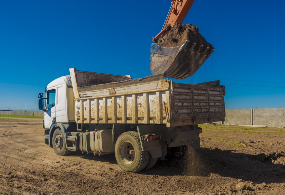 A dump truck, one of the CMVs that can be used on a construction site with a CDL
