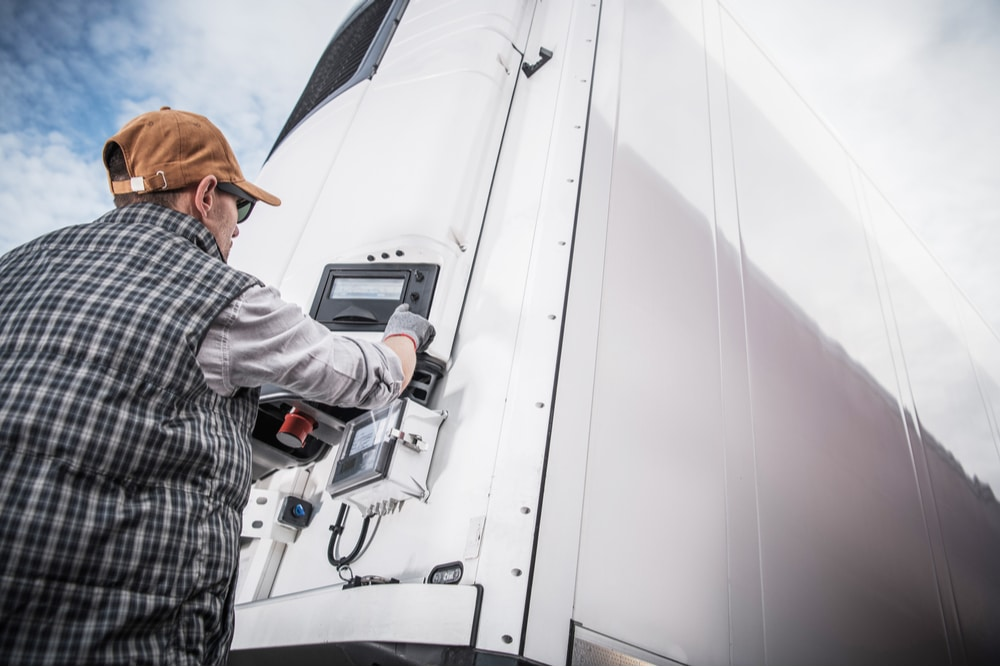 A CDL truck driver setting the temperature for a reefer truck